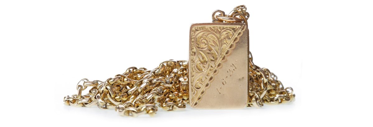 EARLY TWENTIETH CENTURY GUARD CHAIN WITH LOCKET the chain marked 9c, the locket with engraving and hallmarked for nine carat gold, 18.7g gross