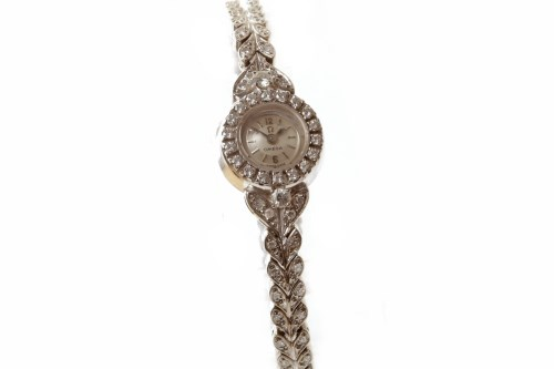 Lot 772-LADY'S OMEGA EIGHTEEN CARAT GOLD DIAMOND SET...