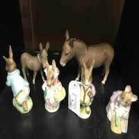 Lot 8-FOUR ROYAL ALBERT BEATRIX POTTER FIGURES along...