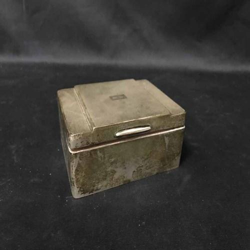 Lot 25-EARLY 20TH CENTURY SILVER CIGARETTE CASKET
