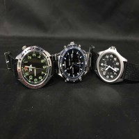 Lot 48-TWO MILITARY STYLE GENT'S WATCHES along with a...
