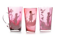 Lot 1223-THREE MARY GREGORY CRANBERRY GLASS BEAKERS each...