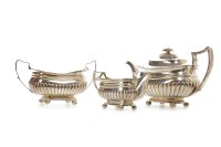 Lot 813-GEORGE III SCOTTISH SILVER THREE PIECE TEA...