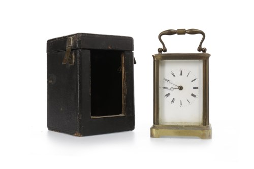 Lot 1405-LATE VICTORIAN CARRIAGE CLOCK the white enamel...
