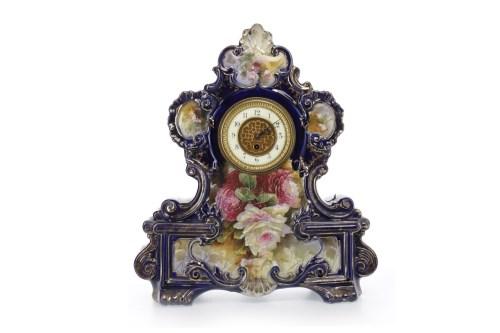 Lot 1408 - LATE VICTORIAN CERAMIC CLOCK GARNITURE one...