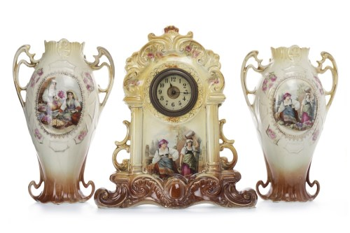 Lot 1417-LATE VICTORIAN CERAMIC CLOCK GARNITURE the cream...