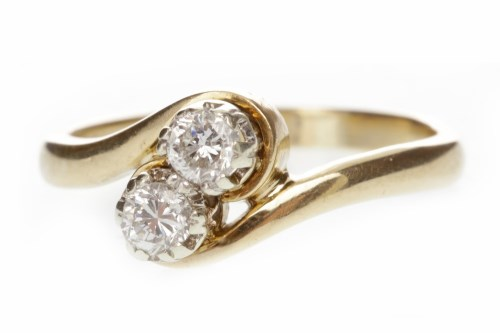 Lot 502 - NINE CARAT GOLD DIAMOND TWO STONE RING set...