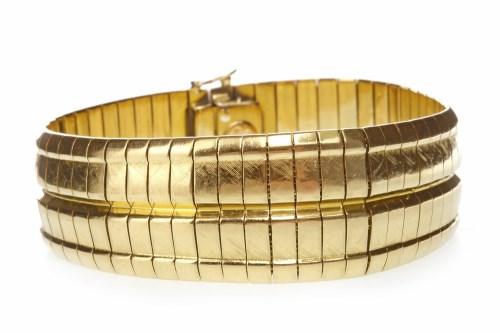 Lot 505 - BROAD GOLD BRACELET formed by rectangular...