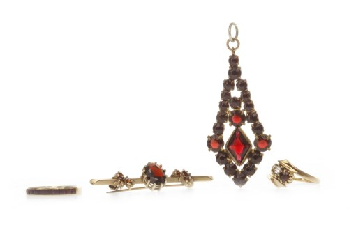 Lot 508-NINE CARAT GOLD GARNET BROOCH 43mm long, 2.5g;...