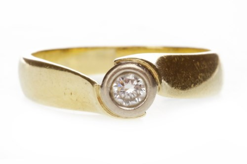 Lot 511 - DIAMOND SOLITAIRE RING set with a round...