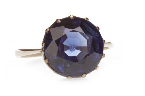 Lot 515-IMPRESSIVE CREATED SAPPHIRE RING set with a...