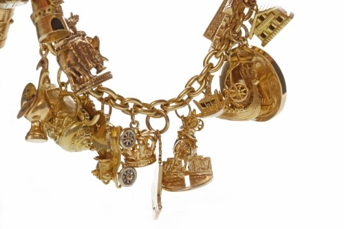 Lot 516-CHARM BRACELET with charms including a postbox...