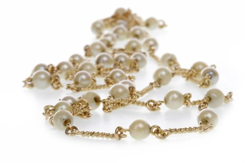 Lot 517-NINE CARAT GOLD FAUX PEARL NECKLACE formed by...