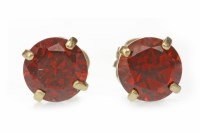 Lot 529 - PAIR OF GARNET EARRINGS each set with a round...