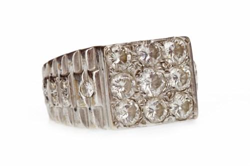 Lot 589 - DIAMOND SET SIGNET RING the square bezel set...