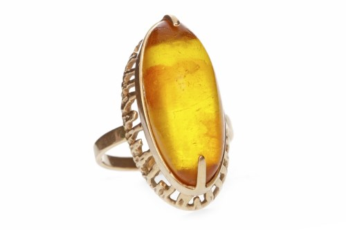 Lot 609 - BALTIC AMBER DRESS RING set with a large...
