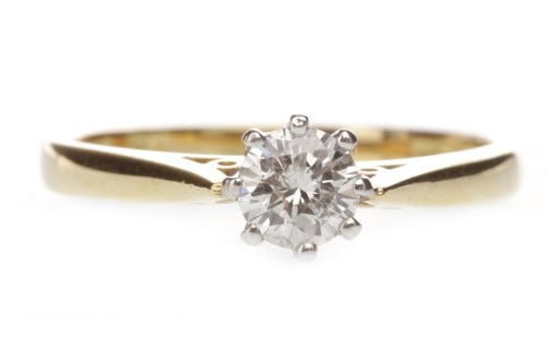 Lot 641 - DIAMOND SOLITAIRE RING with an eight claw set...