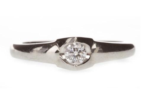 Lot 643 - PALLADIUM DIAMOND SINGLE STONE RING with a...