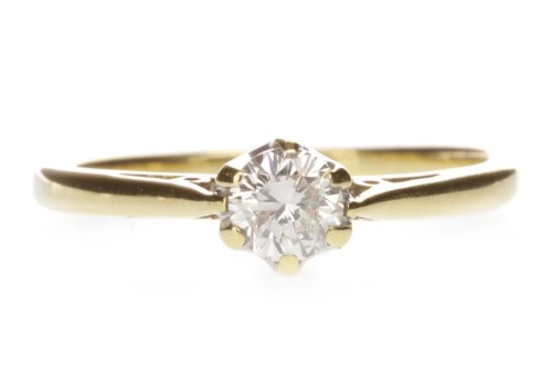 Lot 654 - EIGHTEEN CARAT GOLD DIAMOND SOLITAIRE RING...