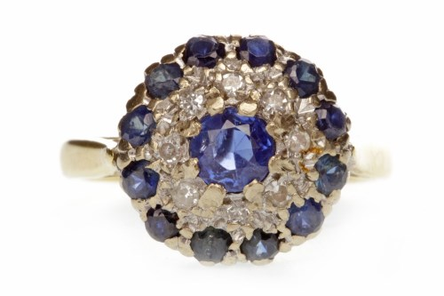 Lot 664 - BLUE GEM AND DIAMOND CLUSTER RING with a...