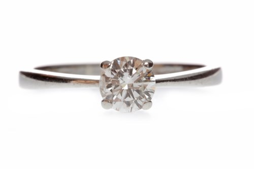 Lot 665 - DIAMOND SOLITAIRE RING with a four claw set...