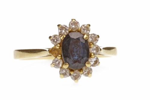 Lot 687 - BLUE GEM AND DIAMOND CLUSTER RING set with a...