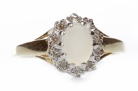 Lot 704 - OPAL AND DIAMOND CLUSTER RING set with a...
