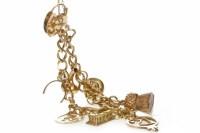 Lot 743 - NINE CARAT GOLD BRACELET with various charms,...