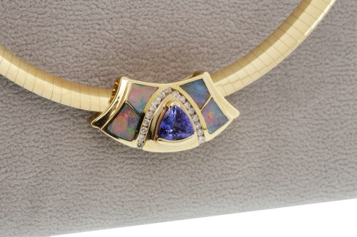Lot 755-TANZANITE, DIAMOND AND OPAL NECKLET with a...