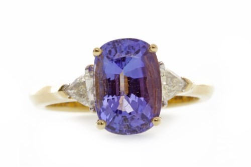 Lot 756-TANZANITE AND DIAMOND RING set with a central...
