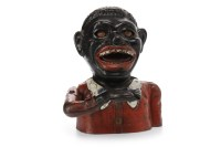 Lot 1656-CAST IRON 'JOLLY' MAN MONEY BANK of typical form, ...