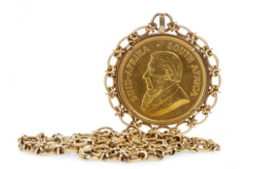 Lot 1-GOLD KRUGERRAND DATED 1974 in an ornate pendant...