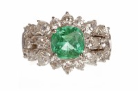 Lot 10-IMPRESSIVE EMERALD AND DIAMOND DRESS RING set...