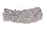Lot 13-IMPRESSIVE ART DECO DIAMOND BRACELET formed by...