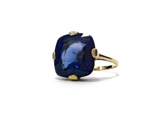 Lot 16-CREATED SAPPHIRE DRESS RING set with a large...