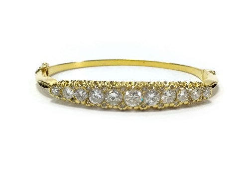 Lot 18-IMPRESSIVE DIAMOND SET BANGLE set with eleven...