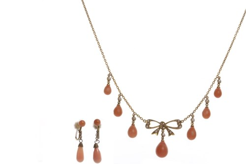 Lot 22-EDWARDIAN CORAL AND SEED PEARL NECKLET with a...