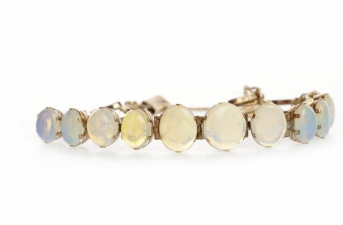 Lot 34-EDWARDIAN OPAL BRACELET set with graduated oval...
