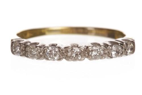 Lot 57-DIAMOND HALF ETERNITY RING set with round...