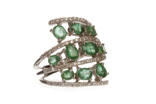 Lot 65-IMPRESSIVE EMERALD AND DIAMOND DRESS RING...