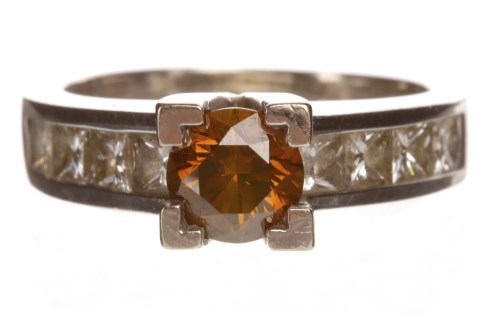 Lot 67-COLOURED DIAMOND DRESS RING set with a round...
