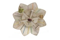 Lot 70-SILVER GEM SET BROOCH of floral motif form, set...