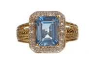 Lot 81-TOPAZ AND DIAMOND RING set with a single emerald...
