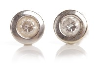 Lot 91-PAIR OF DIAMOND EARRINGS each set with a round...