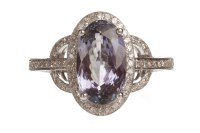 Lot 92-TANZANITE AND DIAMOND RING the oval tanzanite...