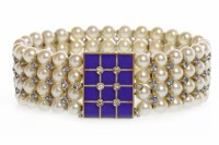 Lot 109-PEARL, DIAMOND AND GEM SET BANGLE formed by four...