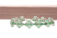 Lot 47-EMERALD AND DIAMOND BRACELET with quatrefoil...