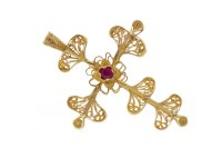 Lot 535-RED GEM SET CROSS PENDANT in canetille work of...