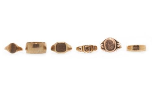 Lot 565-SIX VARIOUS GOLD RINGS comprising a nine carat...