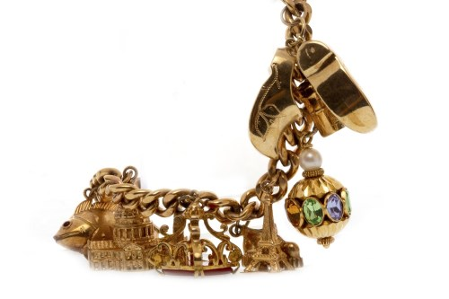 Lot 569-NINE CARAT GOLD CURB LINK BRACELET with charms...